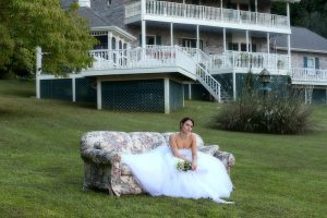 Smoky Mountain wedding bride, outside couch, Smoky Mountain wedding lodge, Smoky Mountain private outdoor wedding, Smoky Mountain private wedding venues, Wears Valley outdoor wedding venues, bride on her wedding day, Smoky mountain wedding flowers